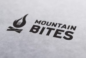 rustic resturant logo, adventure, fire, fork, mountains, bites, adirondack